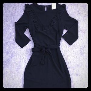 Black dress perfect for dinner or the office !